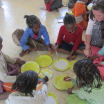 Ashling MacDonagh, a 2012 volunteer, doing artwork with children at St. Joseph's School, Bulbula