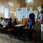 Vincent Conway, volunteer, teaching music and song to a class at Atse school, Addis Ababa.
