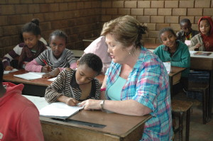 VLM volunteer Kathleen Conlon with Mahari (5th grade) at Atse summer programme in Addis Ababa.