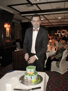 Paul Durcan, Donegall Senior Footballer, cutting the VLM cake on the night.