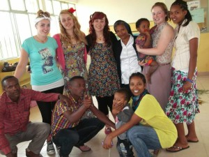 Sabrina with her fellow volunteers and some of the staff of St. Joseph's Primary School.