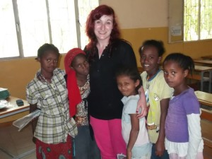 Sabrina Mannion with Grade 4 students in St. Joseph's Primary School, Bulbula, where she taught during Summer 2014.