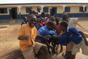 Children play at a school yard well at St. Teresa's Catholic School, Tongo, northern Ghana